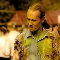 a man in a shirt with coloured powder on his clothes